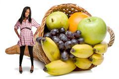 Pregnant Black Woman and a Fruit Cornucopia Stock Photos