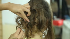 Girl creates a wedding hairstyle - stock footage