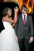 Black Woman and Flaming Man - stock photo