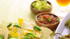 Vegetarian nachos with tortilla chips and fresh jalapeno peppers. Stock Footage