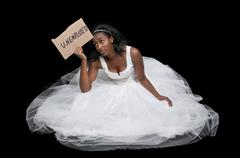 Unemployed Black woman in wedding dress - stock photo