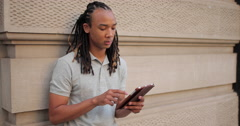 Young African American Black Asian mixed man using tablet Stock Footage