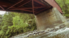 West Cornwall Covered Bridge - underneath, supports and river Stock Footage