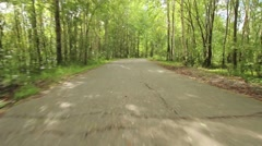 Equipped paved jogging track in the forest park Stock Footage