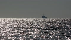 Anchored trawler. Tanker boat at the open sea horizon with sunset reflection Stock Footage