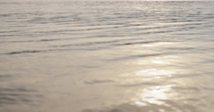 Waves on lake beach closeup macro Stock Footage
