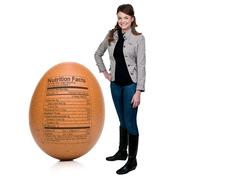 Woman Egg with Nutrition Facts - stock photo