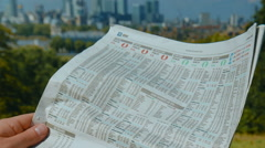 Investor reading a newspaper Stock Footage