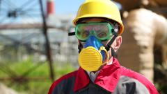 Worker in hard hat, goggles and respirator at power station Stock Footage