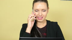 Pretty businesswoman talking on mobile phone at office 1080P - stock footage