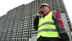 Resident engineer with mobile phone on the construction site Stock Footage