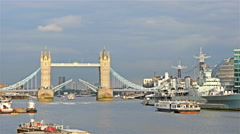 View to river Thames and Tower Bridge opening to let a large boat sail Stock Footage