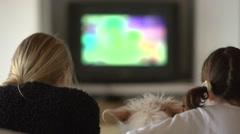 Children watching television with dog Stock Footage