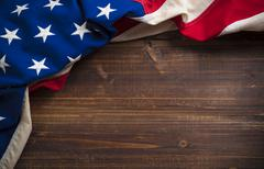 Old American Flag on wooden plank background - stock photo