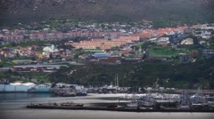 Wide shot of Hangberg fishing village with harbour in the foreground Stock Footage