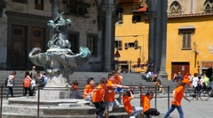 School kids play at historical square in Florence, Tuscany, Italy Stock Footage