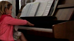 4-year-old girl on  the first lesson piano music Stock Footage