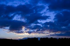 Sunrise in the city - sky above panel houses - stock photo