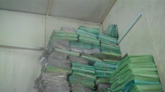Stock Video Footage of Stacks of Reports in Police Station in JUBA, SOUTH SUDAN