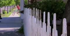 Picket fence and bikes Stock Footage