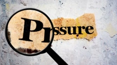Pressure concept and magnifying glass Stock Footage