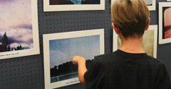 4K children looking at UFO photographs in museum Stock Footage