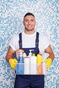 Attractive young stay-at-home man is cleaning his house Stock Photos