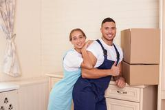 Attractive young cleaners are making fun during clean-up - stock photo