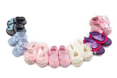 Children's shoes laid in a semicircle. Stock Photos