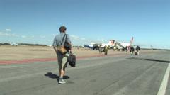 Tourist Walking To His Plane, Lusaka International Airport, LUSAKA, ZAMBIA Stock Footage