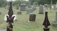 Union Cemetery Iron Fence rack focus to Graveyard, raining - stock footage