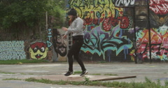 Female Break Dancer Performing in front of Graffiti Wall Stock Footage