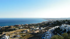 Overview of Málaga town of Fuengirola with the sea at sunset. Stock Footage