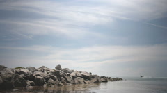 Boat with rock jetty Stock Footage