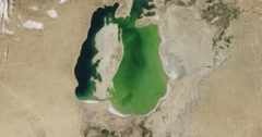 Time lapse shows the Aral Sea losing water from 2000-2015. Stock Footage
