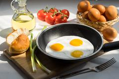 Scrambled Eggs on a Pan and Ingredients Stock Photos