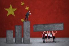 Businesspeople build graph with chinese flags Stock Photos
