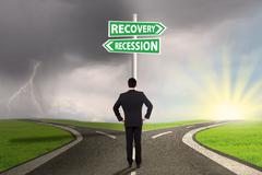 Man with two choices of recession or recovery - stock photo