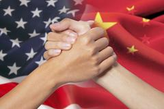 Partnership hands with russian and american flags - stock photo