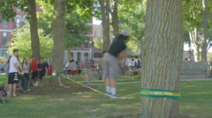 College Students Walking on Slack Line Stock Footage