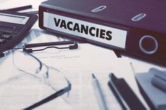 Vacancies on Ring Binder. Blured, Toned Image - stock illustration