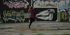 Female Break Dancer Performing in front of Graffiti Wall Arkistovideo