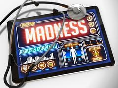 Madness on the Display of Medical Tablet - stock illustration