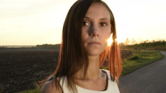 Stock Video Footage of Young Woman on empty road