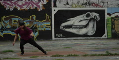Slow motion Female Break Dancer Performing in front of Graffiti Wall Arkistovideo