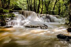 Waterfalls in the tropical rain forest - stock photo