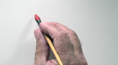 """Human hand writing word """"BONNE ANNEE"""" in french, with red gouache Stock Footage"""