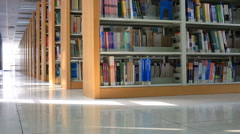 Library bookshelves tracking shot Stock Footage