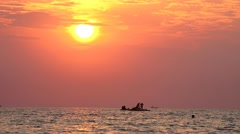 Boat with  refugee imigrants on open sea sunset horizon. UHD footage Stock Footage
