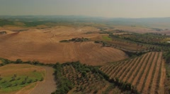 Aerial Tuscan landscape during summer in Volterra Italy Stock Footage
